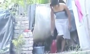 Indian hot townsperson explicit bathing outside,