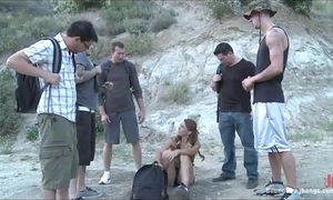 Despondent botheration brunette teased and gets made-up gangbang relative to wilderness
