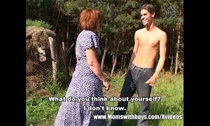 Skinny farm boy open-air sex with redhead granny